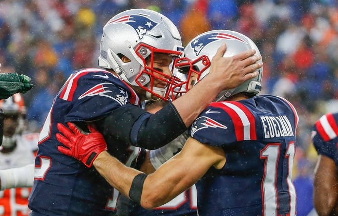 Tom Brady celebrates with Julian Edelman after a touchdown against the Cleveland Browns at Gillette Stadium during the 2019 season.