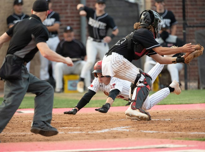 Dawson French of Lake Travis scores under the tag of Bowie catcher Travis Starkey during the 7-3 win by Lake Travis over Bowie on April 13 at Lake Travis High School.