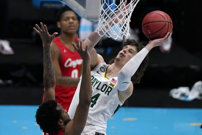 Baylor guard Matthew Mayer, shoots over Houston forward Justin Gorham in an NCAAA semifinal, has declared for the NBA draft but retains his college eligibility. He is a graduate of Westlake High.