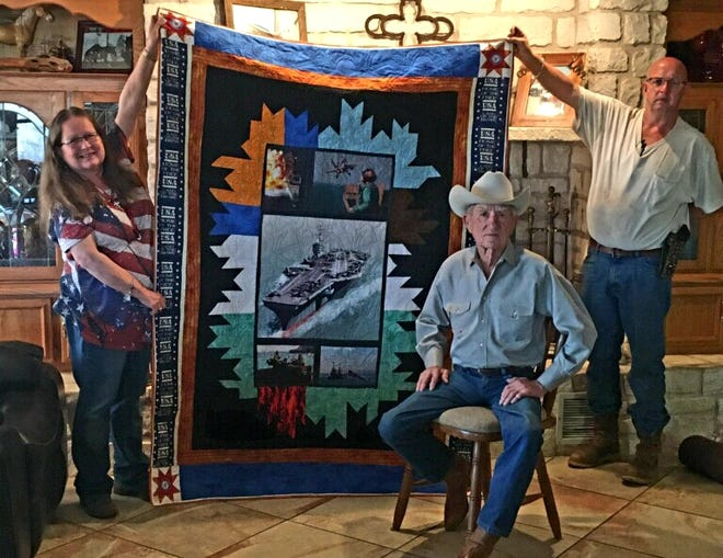 WWII veteran Arthur Goertz (center) was recently honored for his military service with a Quilt of Valor, made by Diane Conner (left) and presented to him by Conner and her husband Ricky (right).