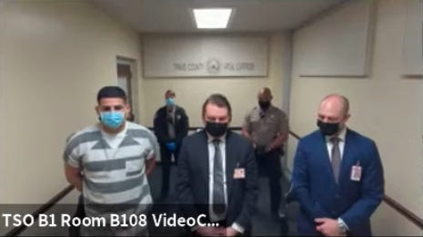 Johnny Leon, left, stands next to his attorneys in a virtual court hearing Wednesday as he pleads guilty to the murder of Austin jeweler Ted Shaughnessy.