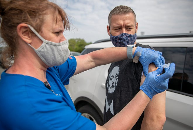 Registered nurse Jana Bayliss, left, administers the second dose of the COVID-19 Moderna vaccine to David Dech at the Kelly Reeves Athletic Complex in Round Rock on April 14.