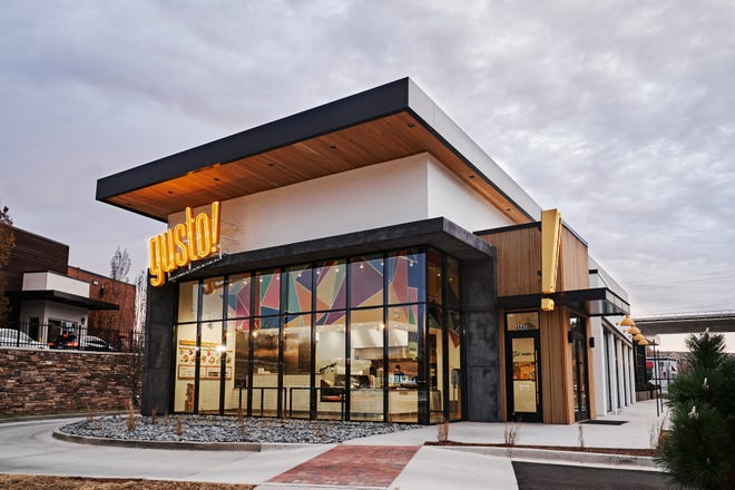 This photo provided by gusto! creator Nate Hybl, a former UGA and NFL player, shows the restaurant's Chamblee, Ga., location. The Atlanta-based business, which offers salads and grain bowls, will open an Athens location in the fall.