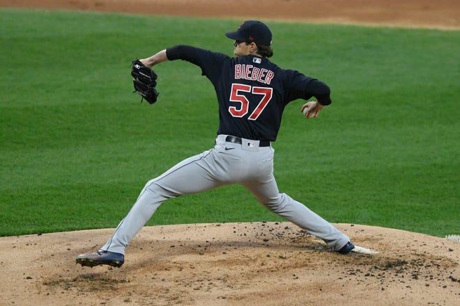 Cleveland starter Shane Bieber gave up three hits and struck out 11 in nine shutout innings of a 2-0, 10-inning win over the Chicago White Sox on Tuesday night. [Paul Beaty/Associated Press]
