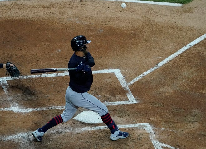Apr 13, 2021; Chicago, Illinois, USA; Cleveland left fielder Eddie Rosario (9) hits an infield single against the Chicago White Sox during the fourth inning at Guaranteed Rate Field.