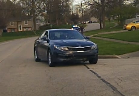 The front passenger headlight of this Kia Optima was allegedly broken during the incident that hospitalized a Stow police officer April 9.