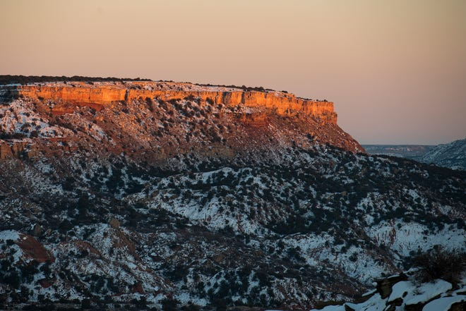 Fresh snow sits in Palo Duro Canyon State park with Fortress Cliff in the background on Feb. 19, 2021.