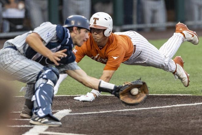 Texas catcher Silas Ardoin scores past Nevada catcher Matt Clayton during Tuesday's 4-3 victory at UFCU Disch-Falk Field. The Longhorns, now ranked No. 3 in the country, have a nine-game winning streak.