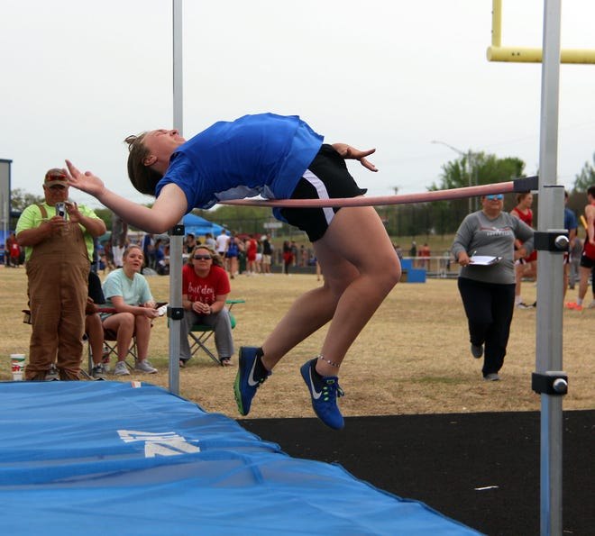 Dickson's Lacie Winchester attempts to clear five feet, two inches during the high jump. Winchester and Kington's Avery Weeks couldn't clear the height, but both cleared five feet, with Winchester taking first place due to number of attempts.