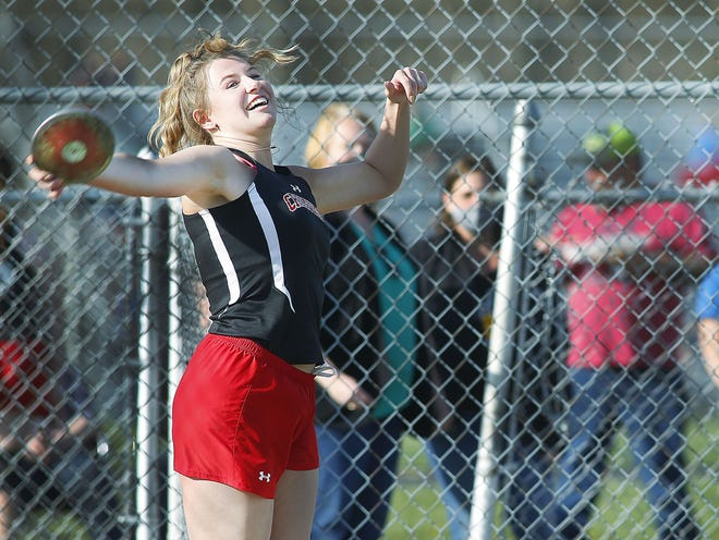 Crestview's Reagan Garrett lets loose a throw in the discus event during a triangular Tuesday at Mapleton High School.