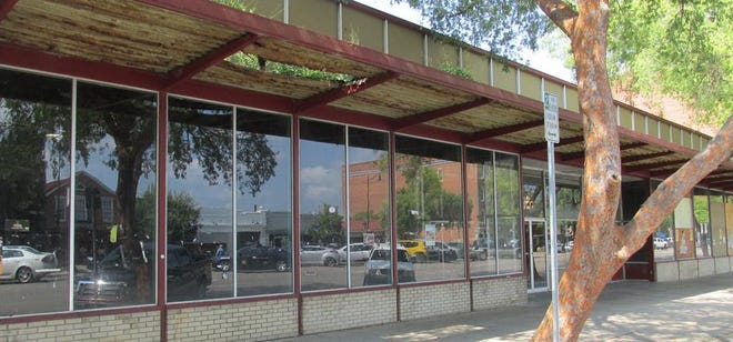 A rusted awning hangs over the former Sky City discount department store on the 1100 block of Broad Street in Augusta. The property has been purchased with the intent to erect an Embassy Suites hotel.