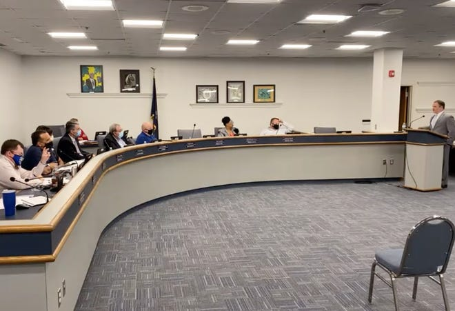 Aiken County Public Schools' Chief Finance Officer Tray Traxler, right, leads the board of education in a preliminary discussion of their 2021-2022 budget on April 13, 2021.