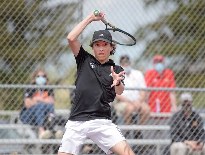 Quaker Valley's Mike Sirianni competes in the WPIAL Class 2A tennis championship against North Catholic's Nicolas Scheller Wednesday afternoon at North Allegheny High School.