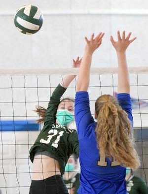 Isabel Alberta of Sturgis West spikes the ball past Lili Crofford of St. John Paul II Wednesday at St. Francis Xavier Preparatory School in Hyannis. The Navigators defeated the Lions, 3-0, to face Nantucket Friday for the Lighthouse League title.