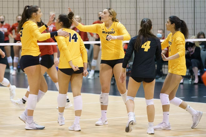 Missouri volleyball players celebrate during a match against South Dakota in the first round of the NCAA Tournament on Wednesday at CHI Health Center Omaha in Omaha, Neb.