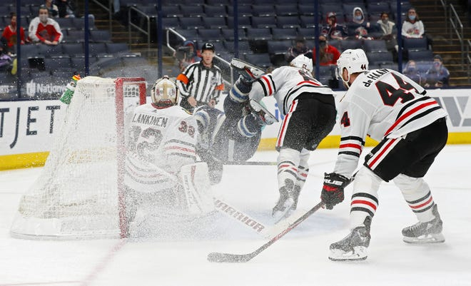 Blue Jackets right wing Patrik Laine goes flying as he scores a goal against Chicago on Monday. It was Laine's second goal of the game.