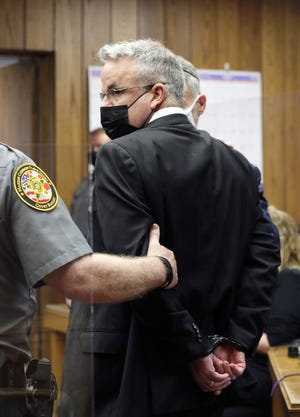 Marion County Judge Jason Warner is handcuffed after he and his wife Julia Warner were sentenced to two years in prison Thursday, April 14, 2021, by Judge Patricia Cosgrove in the Marion County Court of Common Pleas for a June 2020 hit and run that injured a 19-year-old man 2020.Judge Jason Warner was found guilty of complicity to leaving the scene of an accident, a felony of the fourth degree, and complicity to tampering with evidence, a felony of the third degree. Wife Julia Warner, the driver of the vehicle, was found guilty of two counts of misdemeanor negligent assault, complicity to leaving the scene of an accident and complicity to tampering with evidence.