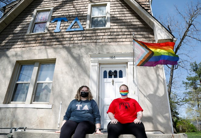Reyana Bates, left, and Cori Fain, right, pose for a photo outside the Tau Delta sorority house at Otterbein University in Westerville. The sorority is gender neutral, and anyone can join regardless of how they identify or their pronouns.