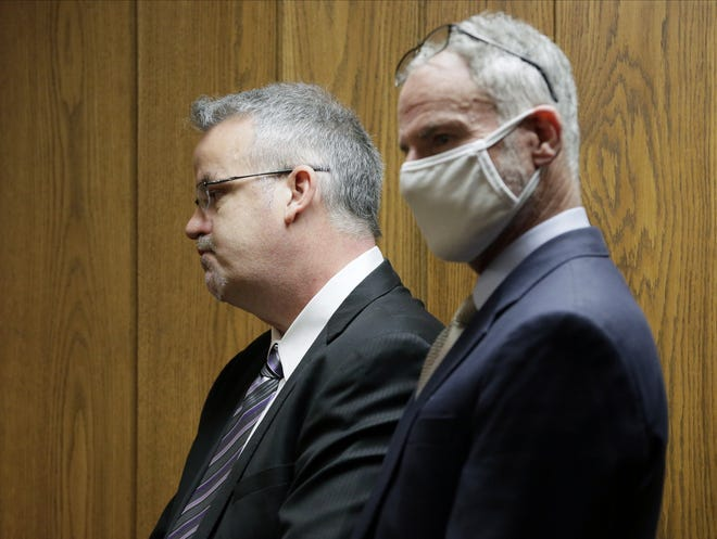 Marion County Judge Jason Warner stands with his attorney Sam Shamansky before he and his wife Julia Warner were sentenced to two years in prison Thursday by Judge Patricia Cosgrove in the Marion County Court of Common Pleas for a June 2020 hit and run that injured a 19-year-old man in 2020. Judge Jason Warner was found guilty of complicity to leaving the scene of an accident, a felony of the fourth degree, and complicity to tampering with evidence, a felony of the third degree. Wife Julia Warner, the driver of the vehicle, was found guilty of two counts of misdemeanor negligent assault, complicity to leaving the scene of an accident and complicity to tampering with evidence.