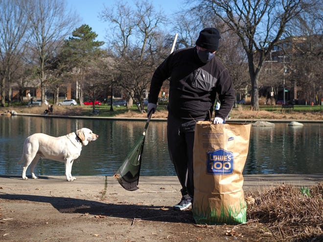 Jason Kentner, a volunteer with friends of Goodale Park, helps with cleanup.