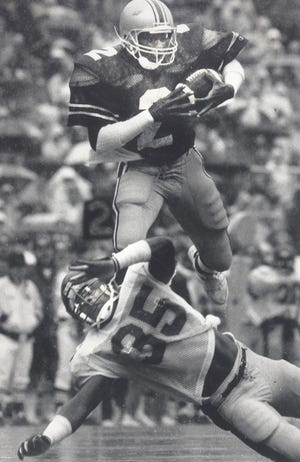 Cris Carter, here running with the ball against Minnesota in 1986, is No. 3 all-time at Ohio State with 168 receptions and 27 touchdowns catches and No. 4 in total yards with 2,725.