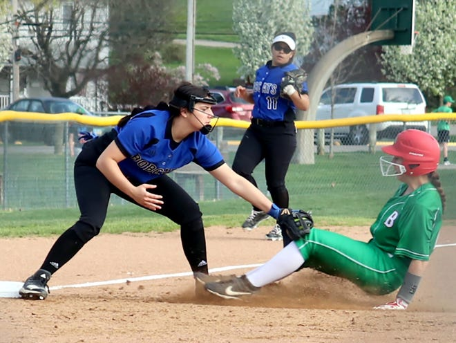 Cambridge's Morgan Bradison applies the tag on a sliding Maddie Schaffer of Barnesville at third to complete a 4-3-5 double play in the first inning on Tuesday in Barnesville.