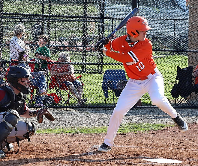 Meadowbrook's Josh Hupp (10) prepares to unload on a pitch during Tuesday's non-league match-up with Dover in Byesville.