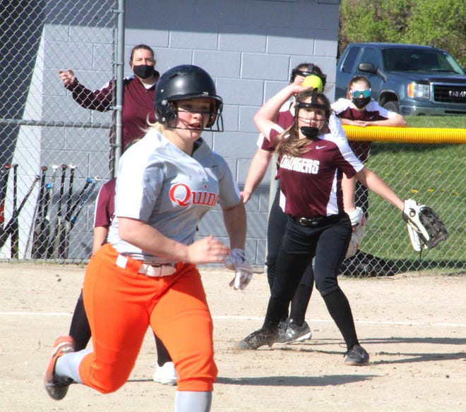 Union City pitcher Carley Gordon, under the watchful eye of first year head coach Kerri Adams, attempts to throw out Quincy's Hayley Wineland on a bunt Tuesday.