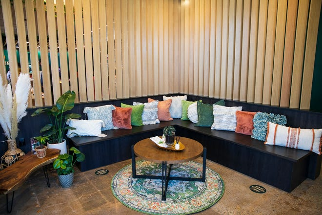The waiting area at Botera, a new recreational marijuana dispensary in Brockton at 747 Centre St, is inviting, with throw pillows and bright, warm lighting, on Wednesday, April 14, 2021.