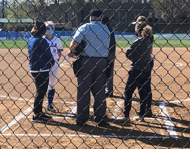 Villa Maria and McDowell softball coaches meet with umpires Tuesday, April 13, 2021, before the Victors and Trojans played a Region 5 game at Villa Maria. The Victors won 8-2.