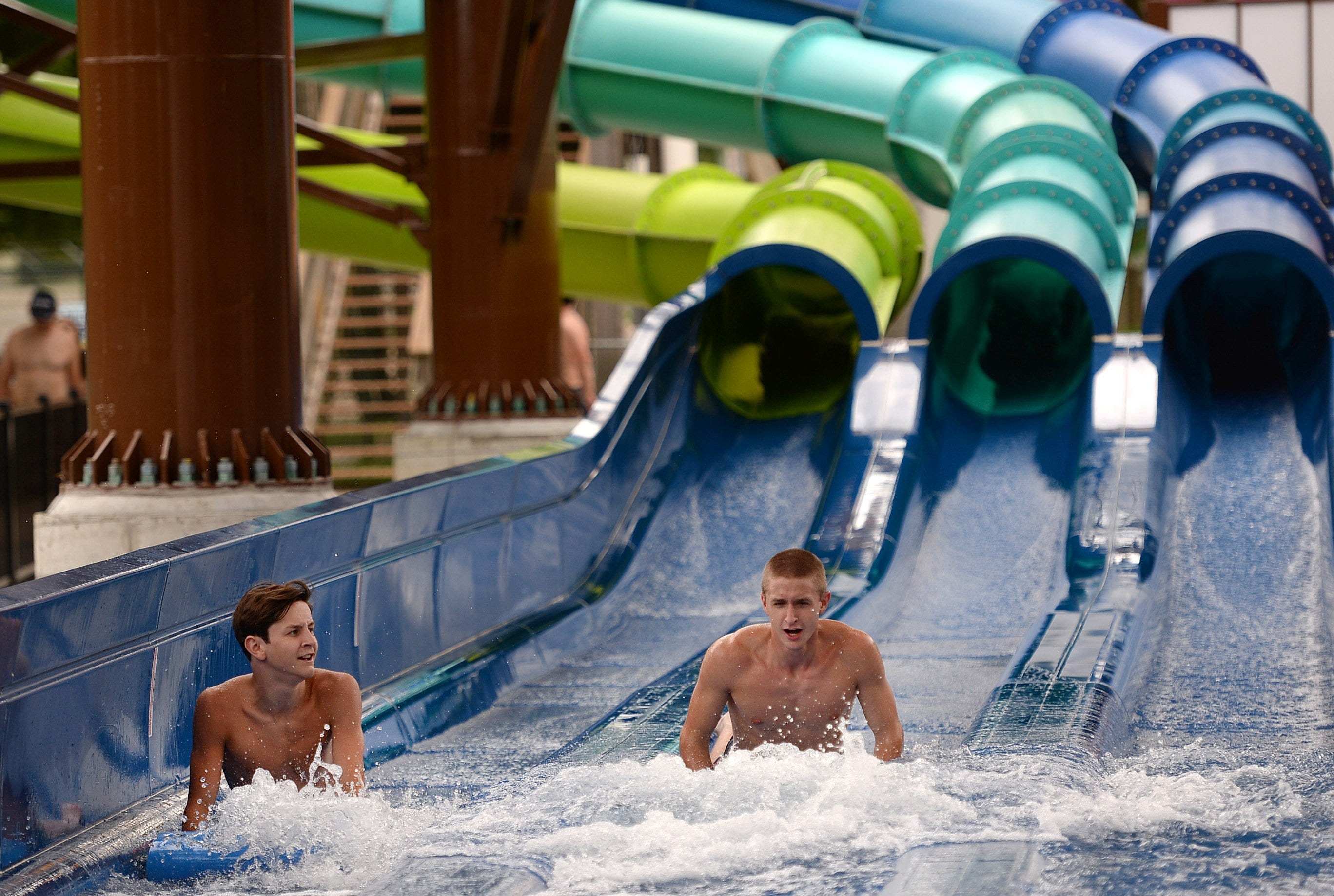 Vincent Kloecker, 16, left, and Peter Frisina, 19, right, both of Erie, ride the Rally Racer on July 22, 2020 at Waldameer Park & Water World in Millcreek Township. Attendance at the park is down due to COVID-19.