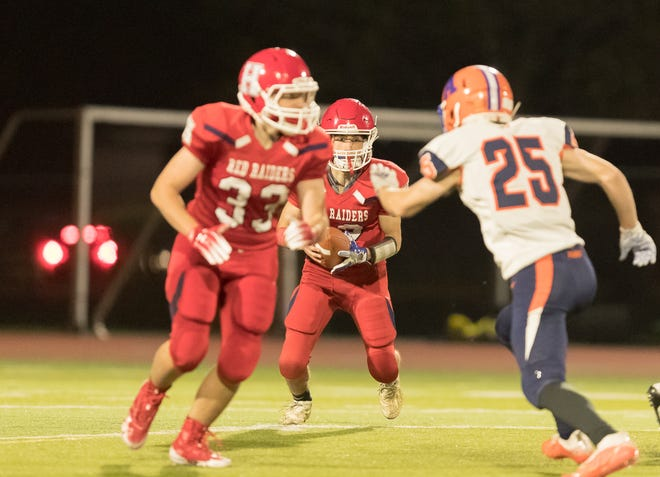 Hornell's Dom Nasca follows the lead block of Hornell's John Mkolajczyk (33) on Tuesday evening at Maple City Park.