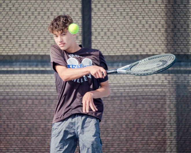 Grain Valley's Carter Compton slices a shot back at Truman's Connor Pointer in their No. 3 singles match Tuesday at Grain Valley High School. Compton won 10-3 and teamed with brother Kade for a No. 2 doubles win as well to help the Eagles to a 6-3 win over the Patriots.