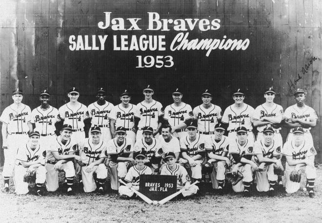 A photo of the newly-integrated Jacksonville Braves minor-league team in 1953 shows future Hall of Famer Hank Aaron standing on the back row at the far right.