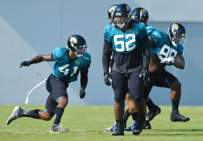Jaguars Defensive Linemen #41, Josh Allen, #52, DaVon Hamilton and #98, Timmy Jernigan run through drills as the Jacksonville Jaguars went through practice in pads for the first time during training camp at the practice fields outside TIAA Bank Field Monday, August 17, 2020. [Bob Self/Florida Times-Union]