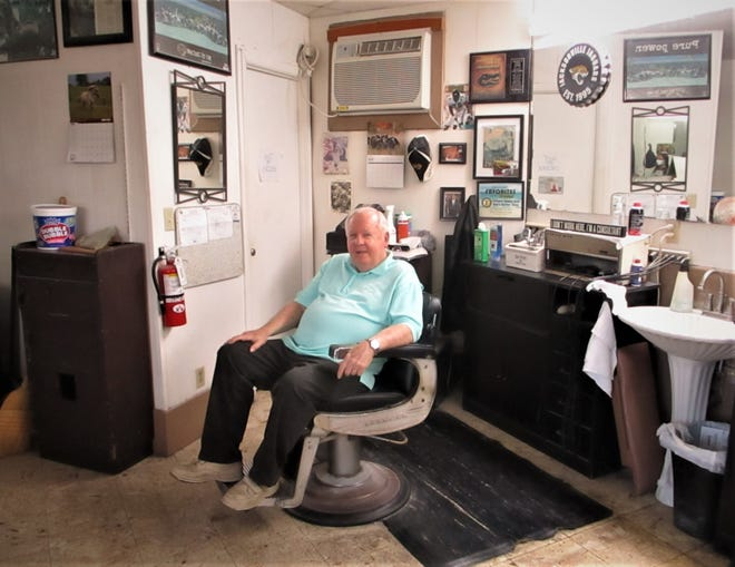 Atlantic Beach barber Bob Thompson sits in the chair where he has cut hair for 60 years. His shop, at the corner of Atlantic Boulevard and Seminole Road, has not changed a lot over the decades.