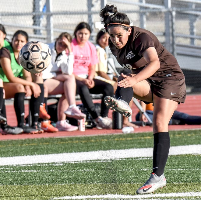 Garden City High School's Wendy Zamudio moves the ball upfield to an open teammate April 8 at Buffalo Stadium against Great Bend.