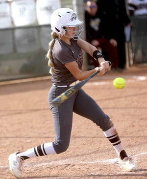 Garden City High School's Brie Manwarren connects with a pitch for a hit during Tuesday's games at Hays.