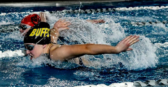 Garden City High School's Avery Meng, foreground, begins to pull away from Great Bend's Ellyson Somers in the 200-yard IM Tuesday during a home swim meet at the Garden City Family YMCA. The race was one of two individual events that Meng won on the day.