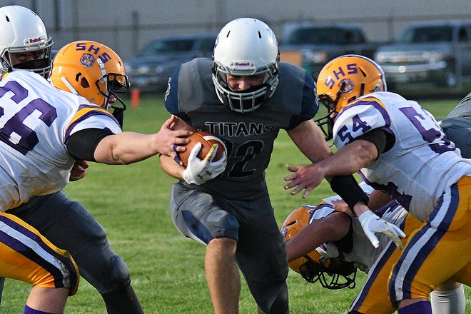 Monmouth-Roseville's Michael Mendoza finds a hole in the Sherrard defense for a touchdown in the first half of  game in Monmouth on Friday, April 9. The Tigers defeated the Titans 34-28.
