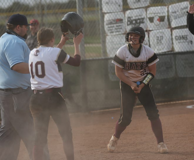Hays High's Lakyn Zimmerman celebrates after Ashlynn Zimmer scored the game-winning run in Tuesday's extra-inning victory over Garden City.