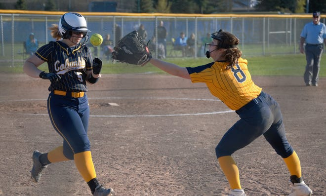 Hillsdale's Gracie Sheffer (8) makes a stop at first base.