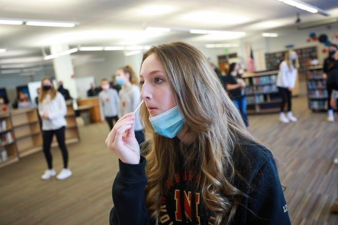 Student Emma Low self-administers a swab on Feb. 26 as part of a pooled COVID-19 testing program at Nock-Molin Middle School in Newburyport.