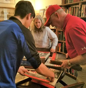 Searching for the original 78-year-old Life magazine in the museum's library.
