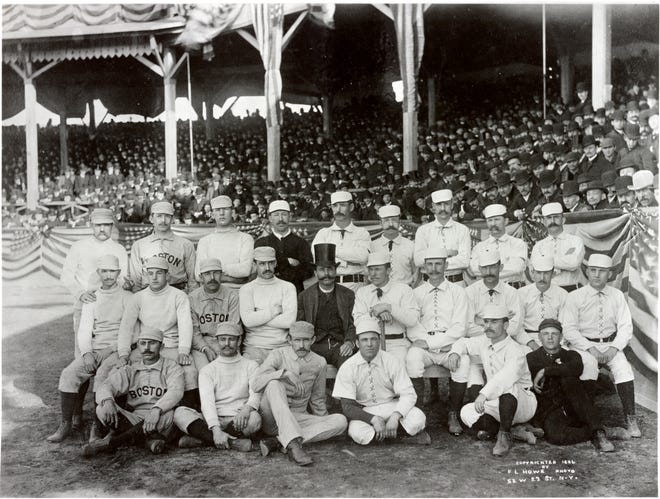 This photo was taken at the opening of the 1886 baseball season at New York's Polo Grounds, before a game between the New York Giants and the Boston Beaneaters. The latter includes Old Hoss Radbourn, standing at far left and slyly extending a middle finger.