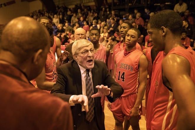 St. Joseph boys basketball head coach Gene Pingatore speaks to his team during their game against St. Rita on Feb. 11, 2017.