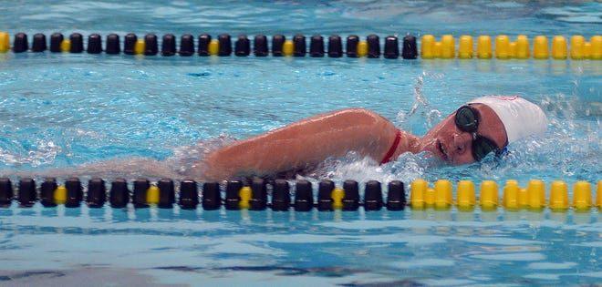 McPherson sophomore Adrien Lochard competes in the 500-yard freestyle at the Newton Invitational.