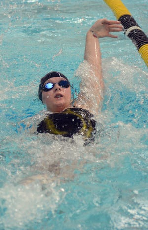 Newton swimmer Madison Horton competes in the backstroke Tuesday at the Newton Invitational I.