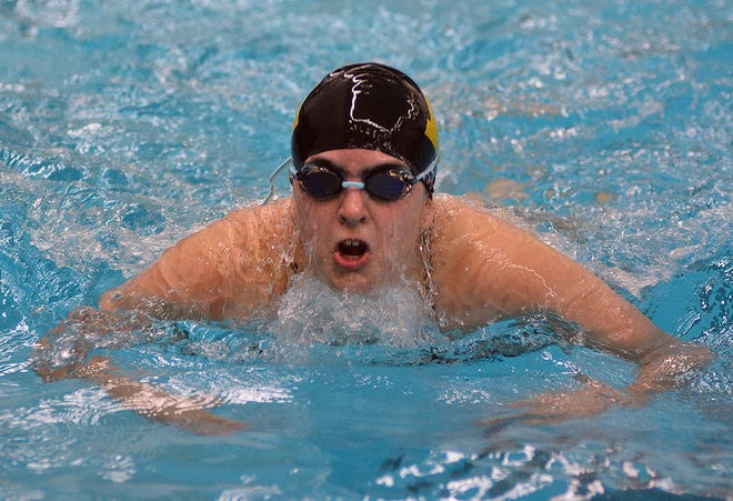 Newton swimmer Libby Crawford competes in the 100-yard Tuesday during the Newton Invitational.
