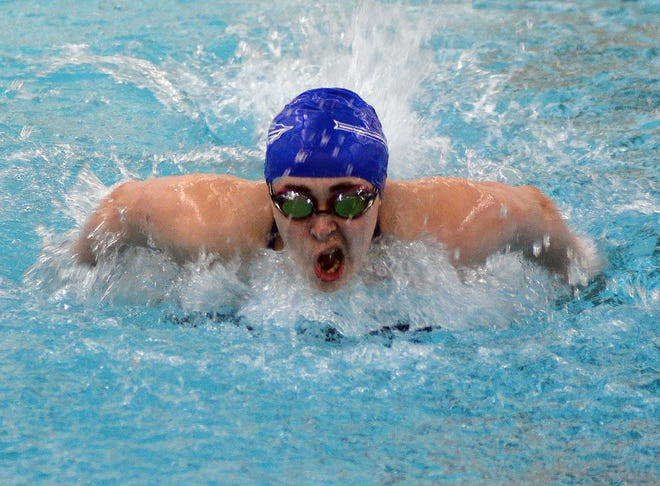 Andover High School swimmer Natalie Neugent competes in the 100-yard butterfly Tuesday at the Newton Invitational. Neugent won both the butterfly and the 100-yard breaststroke leading the Trojans to the team title.